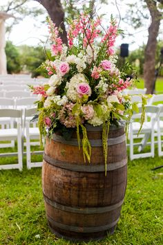 Wine barrels with beautiful arrangements before seating for our ceremony!