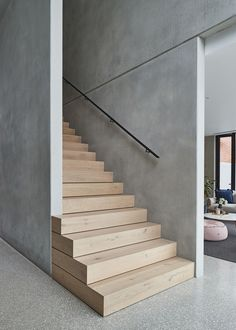 Carefully designed to expose the beauty of raw concrete, Salmon Avenue by FGR Architects creates a strong design statement amongst its traditional Essendon neighbourhood. stairs Salmon by FGR Architects - Exposing the Design Beauty of Raw Concrete Concrete Facade, Concrete Stairs, Precast Concrete, Wood Stairs, House Stairs, Concrete Houses, Stair Railing, Interior Stairs, Interior Design Living Room