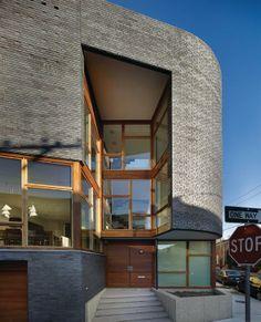 Brick walls, mahogany windows, sapele siding, and the sandblasted concrete entry platform are a twist on traditional neighborhood materials.