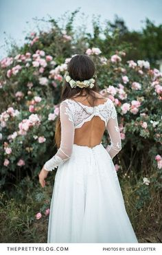 Boho bride with open back lace wedding dress and flower crown | Photo by Lizelle Lotter