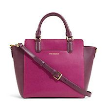This colorblocked satchel has rings on the straps so that they will fold down when not being carried. It can be hand-held or carried with the removable, adjustable shoulder strap.