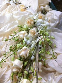 Sheaf bouquet of vendella rose, dendrobium orchids and gold bear grass