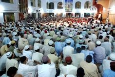 Can a mosque do two Friday prayers because of overcrowding in the mosque?