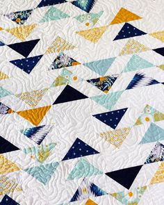 It doesn't get much better than flying geese, but the color way in this quilt just gets me.
