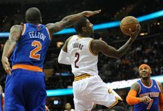 Kyrie Irving (37 points and 11 assists) of the Cleveland Cavaliers, driving between Raymond Felton and Carmelo Anthony.