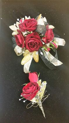 Red spray roses with black and gold accents