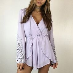 "Lavender Crochet Romper S M A slip on style romper, fabric is very soft in a gorgeous light lavender. Perfect for spring & summer! Waist features an elastic band, very stretchy & comfortable! Features bell sleeves with beautiful crochet detailing. Can be worn with a belt. Fully lined. Size M measures 18"" across the chest and 28"" in length. 100% Rayon. Boutique Other"