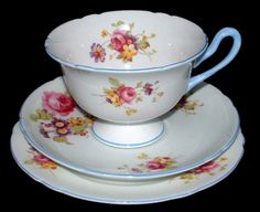 This is a beautiful Shelley China, England teacup trio or cup and saucer with matching plate in the Gainsborough shape and an unknown pattern with blue trim dating to 1940-1966. The cup is 2.5 inches