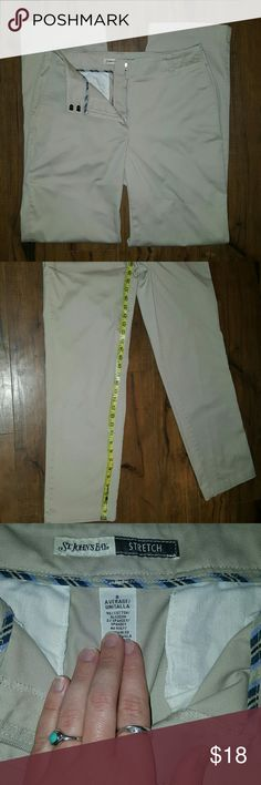 NWOT St. John's Bay Khakis Brand new St. John's Bay khaki pants. Size 8 regular, with stretch. Double hook closure and zip fly. Inseam is about 30 inches. St. John's Bay Pants Straight Leg