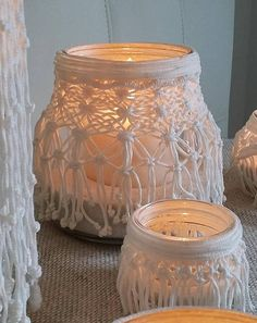 This lantern in macrame fits any décor. It is ideal as centerpieces for weddings, romantic dinners or evenings in the garden with friends. Its soft glow gives atmosphere and intimacy. The lantern in macrame comes with white candle unscented and white sand. Material: cotton cord of