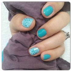 White Romance over Aquamarine Jamberry nail wraps. http://www.tiggygriffin82.jamberrynails.net