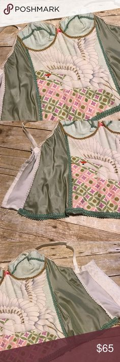 Vintage Silk Corset Beautiful whimsical corset. Red crown crane on bodice. Size 32C. Sold as is. Beautiful cream and sage green.  Please make offer using the offer button.  I believe it's a company out of LA that uses vintage fabrics in their creations.  Deborah Lindquist is the designer/brand Vintage Intimates & Sleepwear
