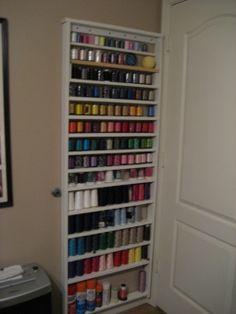 thread storage behind the door (with liquids on the bottom shelf)