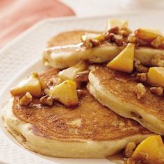 Praline Peach Pancakes: Another gourmet pancake recipe! Fresh fruit with the little crunch of pralines. I think I want to top it with some whipped cream!