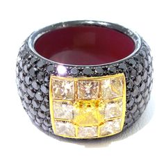Custom designed by Alan Friedman 18kt white gold with black rhodium, yellow diamond, black diamond, and red enamel gents ring.