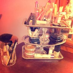 So I saw this on Pinterest a little while ago, and LOVED it. They said they found the materials at a local dollar store, so I did just that. I went to dollar tree and bought three decorative serving Platters, two candle sticks and wah lah! Also bought the container for brushes. All for $7!! Amazing! - Rachel