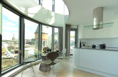 Stunning curved design of the kitchen. Designed by Matthew. Get matched with the right design professional for your home project on www.designforme.com