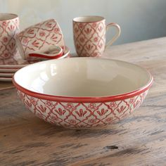 """RED FLOWER SERVING BOWL--If you've wished for your grandmother's dishes, these will fill in admirably. Sturdy stoneware is handpainted with a vintage floral pattern, artfully aged to suggest a prized antique. Imported. 11"""" Dia."""