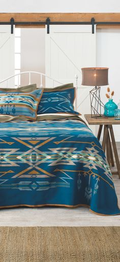 Since ancient times, Native Americans have practiced astronomy to predict the arrival of the brightest stars. Mysterious medicine wheels in Wyoming and Canada track the rising of Aldebaran, Rigel and Sirius, inspiring this dynamic design. Native American Blanket, Native American Decor, Native American Bedroom, Southwestern Bedroom, Southwestern Decorating, Southwestern Style, Pendelton Blankets, Log Cabin Living, American Interior