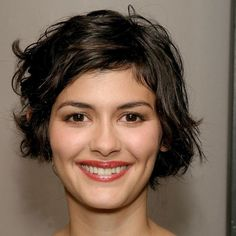 Audrey Tautou, soft neutral eyes illuminated by a slightly shimmery champagne highlighter, paired with sheer berry stained lips