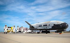 """Unmanned X-37B, which looks like a miniature space shuttle, lands at Vandenberg Air Force Base in California after """"strictly secret"""" mission"""