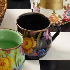 Flower Market Mug - Black: Set a sunny table in glorious color, fresh from a country garden, with Black Flower Market Mugs. The garden-fresh design is color-glazed and hand decorated enamelware with floral transfers. Mix and match colors or pair with Courtly Check® for a fun, fresh look, or for a bold arrangement, choose a single color for the entire table.