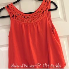A Byer Orange Top A Byer Orange Top with scrunching at the bottom of the shirt and a button closure in the back. See pick for neck line detailing. Great condition. Smoke free. Abyer Tops Tank Tops