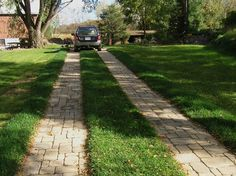 cobblestone driveways | Lanes paved with Cobblestone provide easy access to this provate ... Permeable Driveway, Brick Driveway, Driveways, Cobblestone Driveway, Fireplace Kits, Circular Patio, Raised Patio, Wall Seating, Concrete Pavers