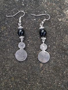 Earrings - Spiral of life with Onyx by Nattspinnas on Etsy