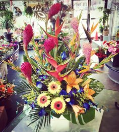 Tropicals! Lovely ginger, heliconia, blue orchids, lilies, roses and glads.