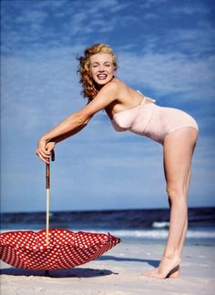 Marilyn Monroe  See, even beautiful, sexy women had a little gut to them.