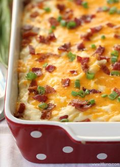 Cheesy Mashed Potato Casserole - this side dish is AMAZING! It's filled with potatoes, cream cheese, sour cream, butter, cheese, bacon and more. It's easy too - definitely a new family favorite!