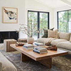 Neutral vibe living room design with oatmeal colors couch, poufs, and large rectangular wood coffee table - Amber Interiors Home Living Room, Living Room Designs, Living Room Decor, Living Spaces, Bedroom Decor, Furniture For Living Room, Living Room Layouts, Coffee Table Decor Living Room, 60s Bedroom