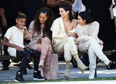 Something funny? Before the show began, Kendall and Kim were seen sharing a joke with TV host La La Anthony - wife of NBA star Carmelo Anthony - and her son Kiyan