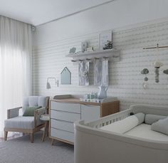 Clever nursery, check the pockets on the feeding chair for a bottle of water or a book while feeding, with a side table and lamp nearby. Lovely look as well. Very mom friendly.
