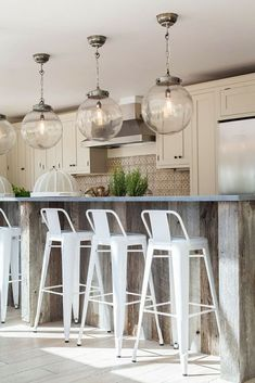 Three glass globe lights are amazing in this kitchen! Perfect with LED Filament >> http://www.standardpro.com/featured-product/led-filament-lamps/