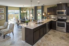 Love the Tile Floors and the Dark Cabinets