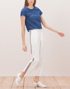 At Stradivarius you'll find 1 Carrot pants with striped side band for woman for just 5.99 £ . Visit now to discover this and more TROUSERS.