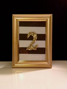 black and gold table number sign