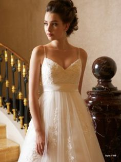 empire waist, spaghetti straps and tulle skirt with lace detail <3