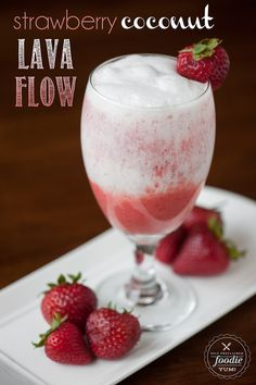 This blended non-alcoholic Strawberry Coconut Lava Flow made with fresh strawberries, pineapple juice and coconut cream is the perfect tropical mocktail.