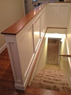 Half walls around basement stairs.board and batten on half walls, paired with wood. Architecture Renovation, Attic Renovation, Attic Remodel, Stairs Architecture, Open Basement Stairs, Open Stairs, Basement Flooring, Upstairs Hallway, Stairs Trim