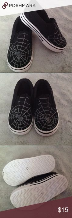 Infant Spiderweb Slip On Shoes Size 5 Great condition, hardly worn. These infant slip on shoes have a black canvas upper with a gray spiderweb detail. Black and white soles. The only flaw is a slight mark on one of the shoes near the opening, but it can likely be cleaned and isn't noticeable. Size 5, see photos for measurements. Shoes