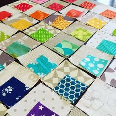 "The idea was a low volume quilt with rainbow ""bites"" throughout the patchwork."