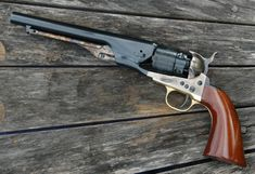 The Colt 1860 Army Model .44 caliber, became the standard weapon of the Union Calvary during the Civil War and, was used by gunfighters and lawmen alike, including the Texas Rangers. Reproductions have been popular with many cap-and-ball black powder competitors in cowboy action shooting. Pictured is the Cimarron/Uberti version. The cylinder roll is engraved with a scene that commemorated the defeat of the Mexican Fleet by the Texas Navy at the battle of Compeche in 1843.