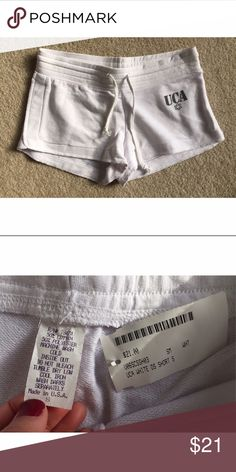 ⋙NEW LIST⋘ NWT UCA White Cheer Shorts Cute UCA (Universal Cheerleaders Association) white cheer shorts with grey logo Drawstring at waistband    New W/ Tags, never worn  Size: Small 50% Poly, 50% Cotton  PRICE FIRM, unless bundled  ⟨Bundle & save ≫ One time shipping fee⟩ NO trades Shorts