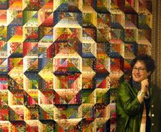 "Anita Grossman Soloman - Mitered Log Cabin Quilt.  I am in awe and in love with this quilt.  Included in her book ""Rotary Cutting Revolution""."
