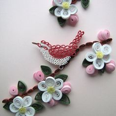 Quilling white and pink flowers with red bird