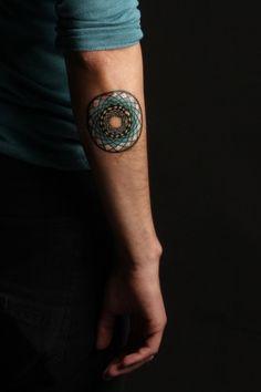 Colourful geometric tattoo