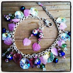 """Fresh Flowers Bracelet Set $30.00 Free Shipping! Bracelet/Anklet 10"""" with lobster clasp. Iridescent crystals, baby pink glass leaves, faceted green grass beads and clear bicone crystals, Sapphire Iris faceted blue glass tied in with Navy blue cloisonné beads with blushing pink flowers and pink Swarovski crystals. Earrings-2""""Length-Sterling Silver earring wires. Navy blue cloisonné floral beads with blushing pink Swarovski crystals and baby pink glass leaf dangles."""